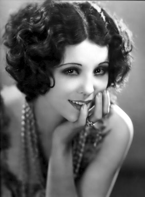 1920's fashion and hairstyle as demonstrated by actress Raquel Torres