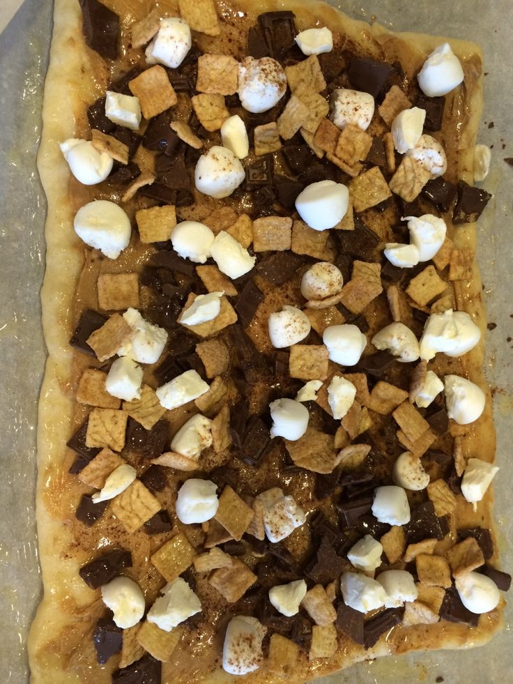 """S'mores pizza. Unbelievably delicious and super simple. The dash of sea salt makes this the perfect """"mostly sweet, but with a dash of salty-ness"""" treat!"""