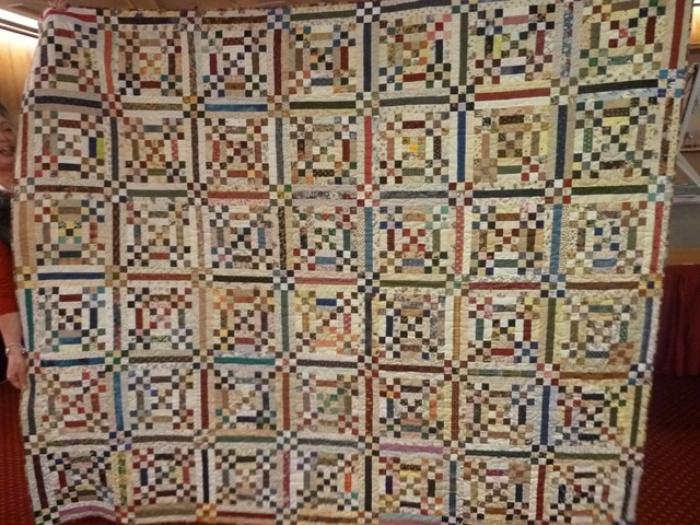 Great scrappy quilt using nine patches