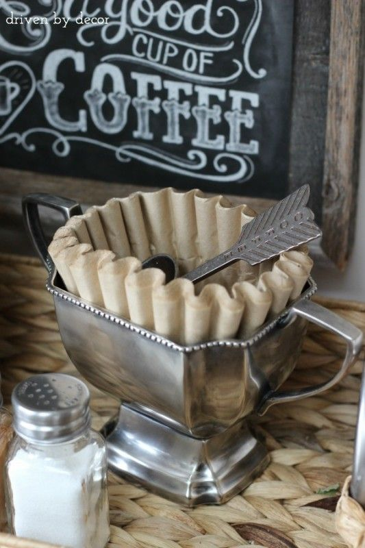 Trophy cup holds coffee filters and spoon as part of home coffee bar!