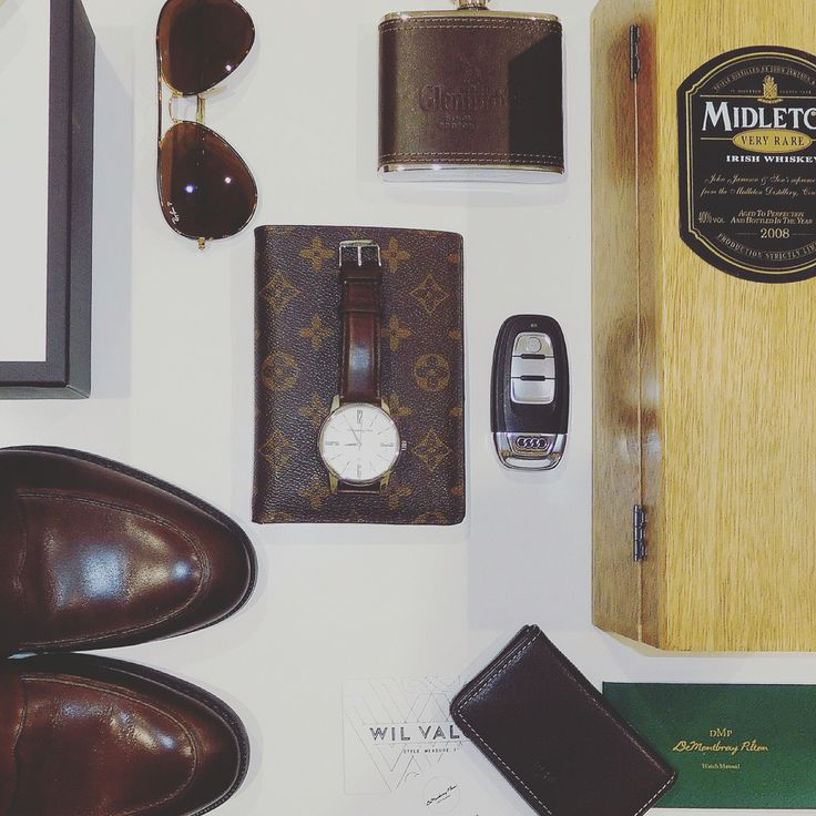 Watch, whiskey, wallet and shoes