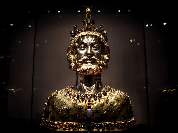 The Bust of Charlemagne is a reliquary in the form of the bust of Charlemagne made around 1350, which contains the king's skullcap. The reliquary is part of the Late Medieval treasure kept in the Aachen Cathedral Treasury. It is one of the most significant examples of Gothic goldwork and the best-known example of a reliquary bust anywhere. The reliquary is an idealised image, not an actual portrait of Charlemagne.(Click on the image. It's breathtaking.)