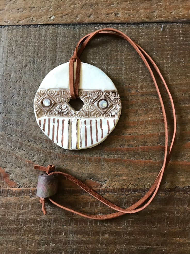 Rosetta Stone? Rustic, Antique looking Pendant Necklace. Polymer Clay, Rawhide Cord