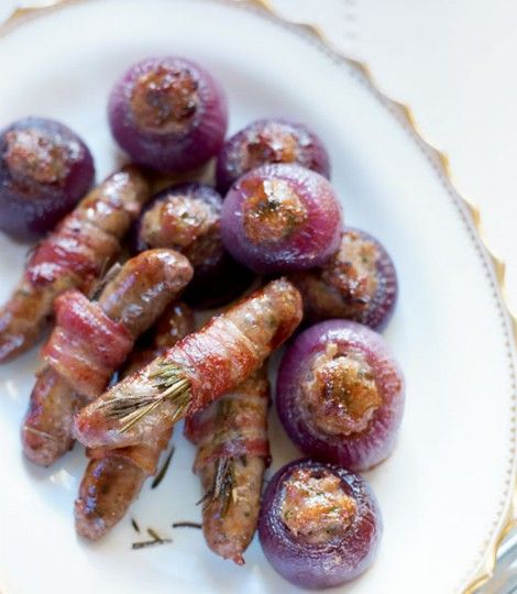 These sausages wrapped in bacon with rosemary are best served at Christmas lunch with the stuffing-filled roasted red onions