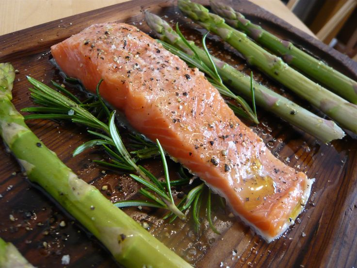 Honey-Mustard Salmon with Grilled Asparagus - Flaky and flavorful salmon filets rubbed with a honey-mustard glaze and served with a side of grilled asparagus. This is a delectable dish that is enjoyably fulfilling. Incredibly simple and quick to make with very few ingredients needed, but the taste is gourmet and the presentation sophisticated.