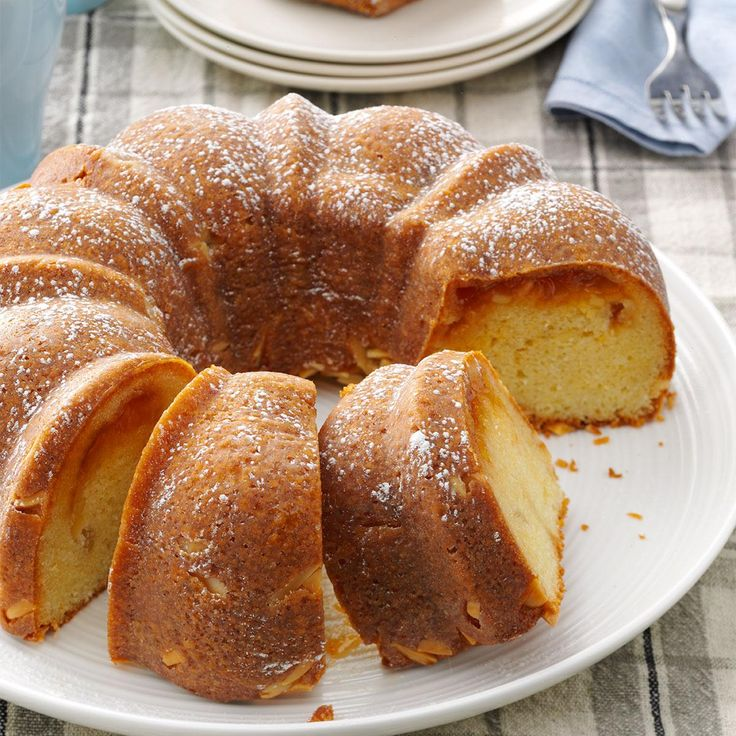 Almond Apricot Coffee Cake Recipe -The nutty aroma and delicate fruit flavor make this cake special enough to serve to company. Strawberry or raspberry preserves can be used as a tasty variation. —Sharon Mensing, Greenfield, Iowa