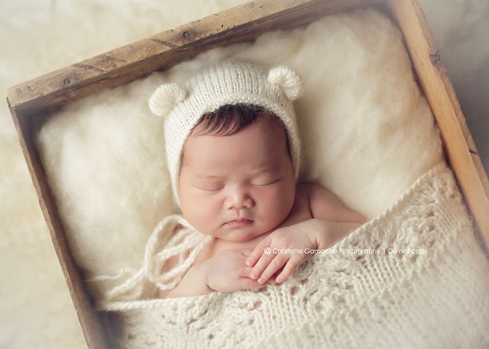 Vancouver newborn photography basket newborn photography props studio lighting bonnet wrapped up baby white wood overhead angle newborn po