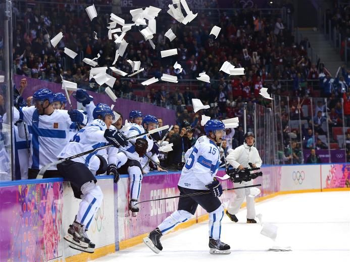 Sami Vatanen #45 and Tuomo Ruutu #15 of Finland celebrate with teammates after defeating the United States 5-0 during the Men's Ice Hockey Bronze Medal Game