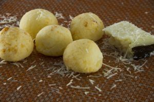 Recipe: Pao de queijo -- gooey, chewy cheese puffs that are a basic snack and breakfast food in Brazil.