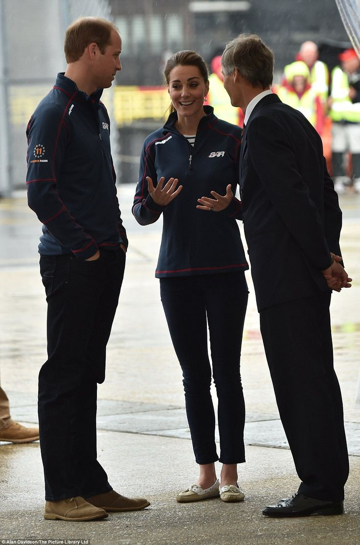 Dressed down: The Duke and Duchess of Cambridge appear in high spirits despite the miserable weather as they are greeted at the Royal Naval base in Portsmouth