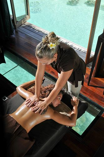 Relaxing massage in the overwater spa suites with glass botom InterContinental Bora Bora  Resort & Thalasso Spa Deep Ocean Spa