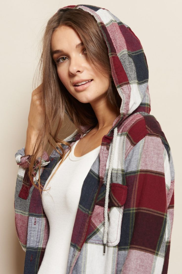 Your new go-to. This hooded boyfriend flannel shirt features a classic plaid pattern and a super comfy fit!