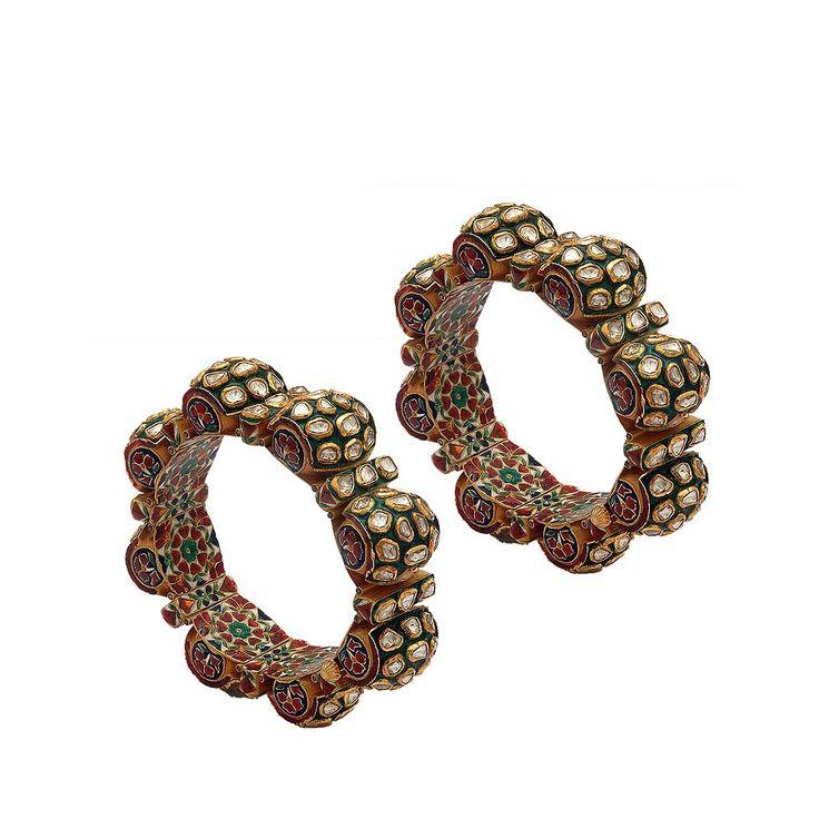The kundan polki and enamel bangles by Anmol, worn by Malaika Arora Khan on the occasion of her wedding.