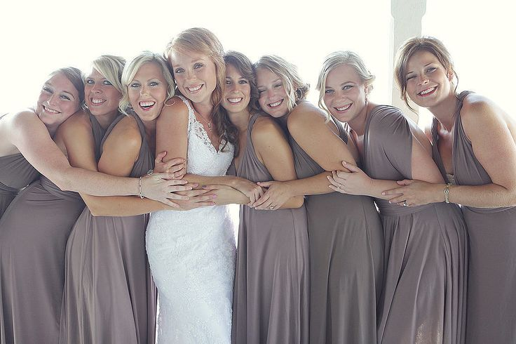 Happy and Hugging: See the full wedding here. Photo by Dana Laymon Photography
