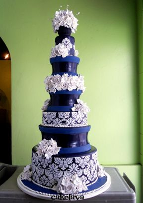 Damask Wedding Cake- should be shorter and more modern without the topper... but the idea of it is awesome!