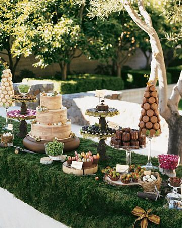 Outdoor dessert table with moss runner.