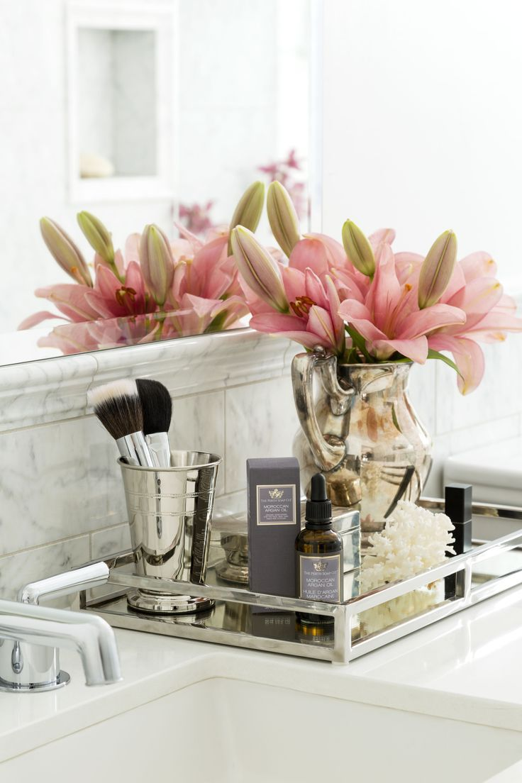 Group products that work together and display on mirrored trays. Fresh flowers always look gorgeous too #vignette: