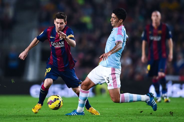 Lionel Messi of FC Barcelona competes for the ball with Charles of Celta de Vigo the La Liga match between FC Barcelona and Celta de Vigo at Camp Nou on November 1, 2014 in Barcelona, Catalonia.