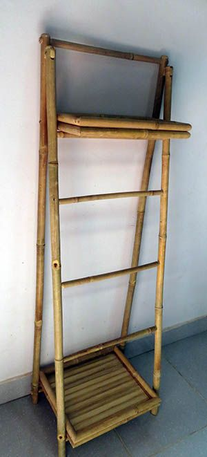 This bamboo ladder shelf is great for compact spaces such as a laundry or rest room. It consists of two shelves and three hanging rods and is hand crafted from natural solid bamboo.