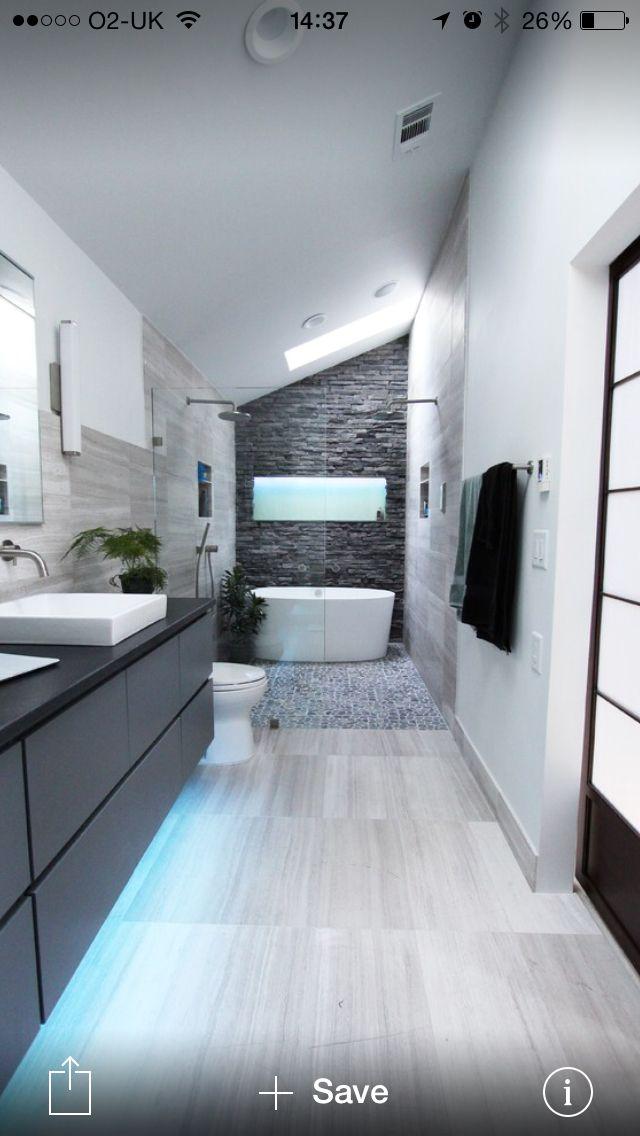 Dark bathroom split face tiles