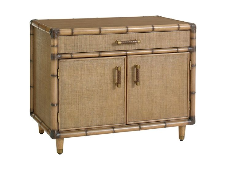 Lighten up! Make your home office as bright and breezy as the rest of your home with this gorgeous, tropical style storage chest. This office storage piece is the perfect match for your fun-loving, globe-trotting personality with its destination resort inspired carved bamboo mouldings and woven raffia panels. The two doors, one drawer, and two adjustable shelves inside provide ample storage space. It can be used anywhere in the home, but its especially nice for storing books, printer paper…
