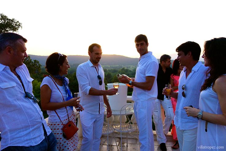"""Saint Tropez, there's nowhere else in the world where the pink hue of rosé wine co-ordinates so well with the crisp white linens of birthday party guests.  What a special way to celebrate whilst on holiday in France, with this """"diner en blanc"""" theme, in French Riviera dinner style."""