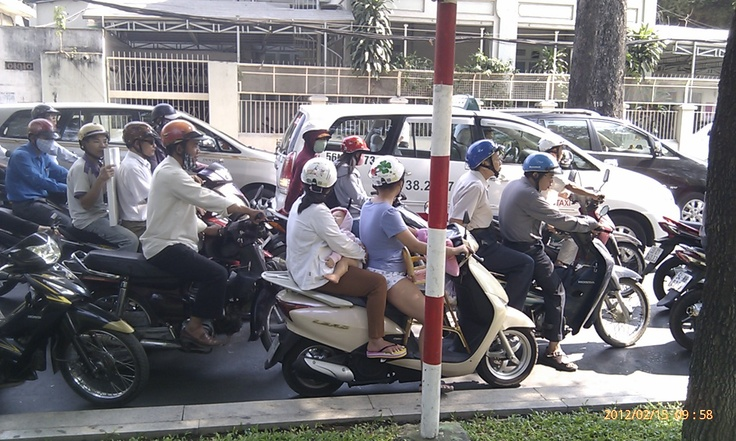 Residents of Ho Chi Minh City can do anything on board a motorcycle. Sleeping babies were a common sight.