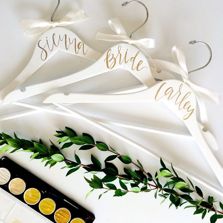 WEDDING HANGERS // Personalized Bridal Party Hangers, Bridesmaid Gift, Maid of Honor Gift, Hand Lettered Wedding Hangers ( White & Gold ) by FoxandSparrowDesign on Etsy https://www.etsy.com/listing/273662462/wedding-hangers-personalized-bridal