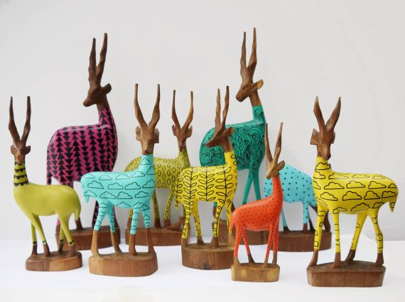 Original 1970s wooden carvings from Africa. They have been sanded and painted modern, eye popping colors with and illustrative motifs.  ||  Handsome Vintage on Etsy