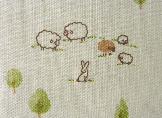 This is totally the style we're after - simple and in soft, neutral shades. With sheep!
