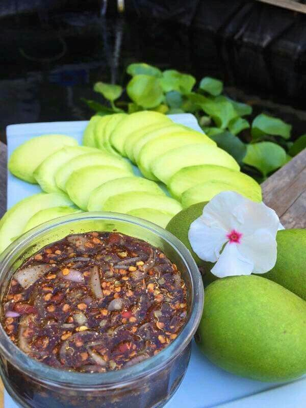 Spicy sauce and green mango. Lao snack/appetizer.