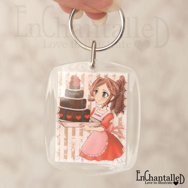 Deze prachtige anime sleutelhanger met de illustratie 'Manga meisje met taart' is ideaal om je sleutelbos of tas op te leuken.