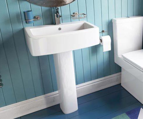 A designer, square pedestal basin, featuring a full pedestal and angular wash bowl.
