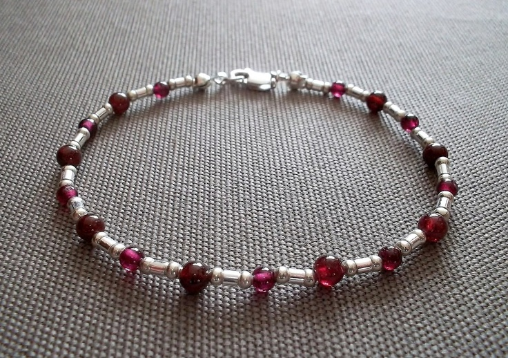 Handcrafted bracelet featuring 3mm and 4mm genuine garnet beads, and sterling silver beads and clasp. 8 inches in length.