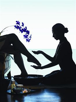Lovely photograph of a pampering foot spa treatment. A relaxing foot massage at the Spa.