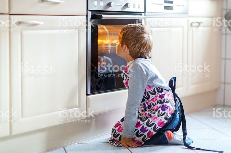 Funny blond kid boy baking muffins indoors royalty-free stock photo