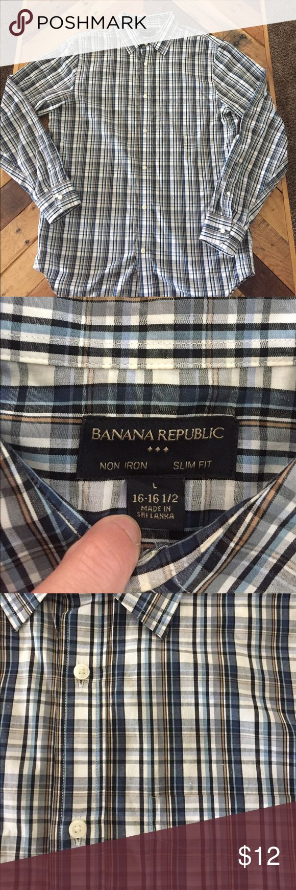Banana Republic men's slim fit dress shirt (L) Banana Republic men's plaid button down shirt (large). Non-iron, slim fit, 16 - 16.5.  Beautiful plaid (blues, white, tan).  Great shirt, worn only a few times and in great condition. Banana Republic Shirts Dress Shirts