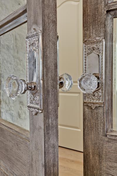 Stunning combination of glass knobs with these beautiful wood doors. The combination of rustic with a touch of elegance is perfect!
