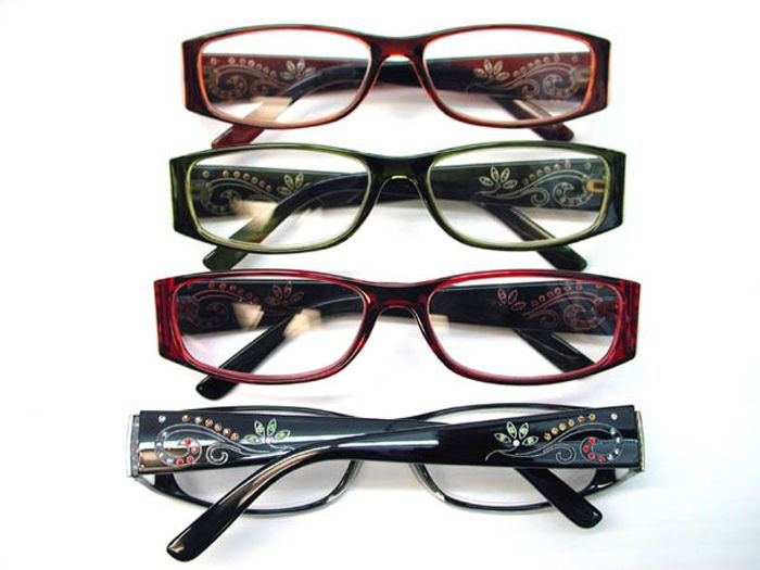 Two tone translucent color with black  readers featuring five colors of rhinestone swirls and flower design on the wide profile arms.