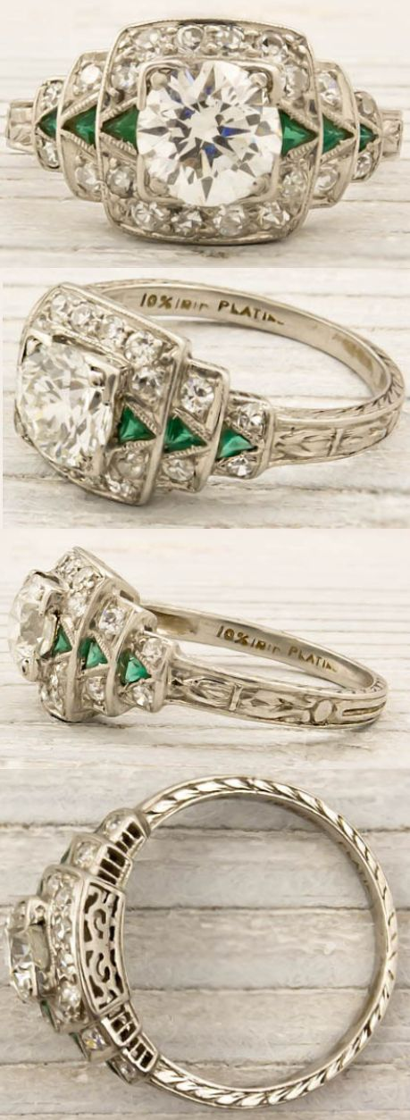Art Deco engagement ring, circa 1925. Featuring a .79 carat (approx) EGL certified old European cut diamond with F-G color and VS1 clarity. The center stone is accentuated by a row of triangle cut emerald arrows on ether side, and single cut diamonds all around the geometric platinum setting. Via Diamonds in the Library.