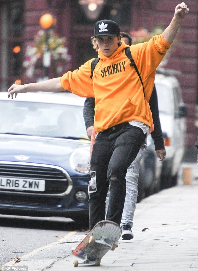 Free-wheelin': On Monday it was back to the grind (quite literally) for Brooklyn Beckham, as the eldest of David and Victoria's brood headed out in London for a skate