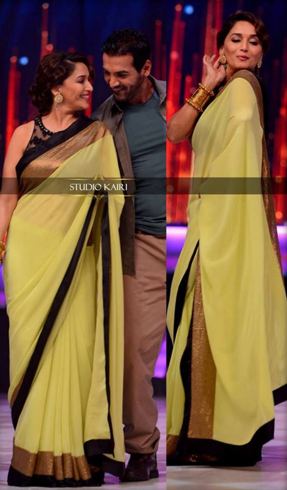Madhuri Dixit on the sets of Jhalak Dikhlaja! .. in a #Gorgeous #yellow #Saree!   SHOP our saree collection @ https://www.studiokairi.com/category.php?category=Sarees and avail 15% discount with code: SAREESALE15. applicable on ALL sarees. valid till 9-Aug