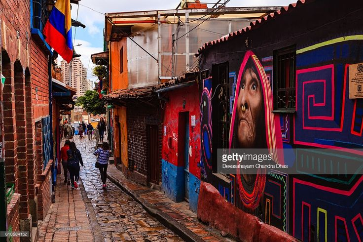 Stock Photo : Bogotá, Colombia - People Walk Through The Narrow, Colorful, Cobblestoned Calle del Embudo In The Historic La Candelaria District