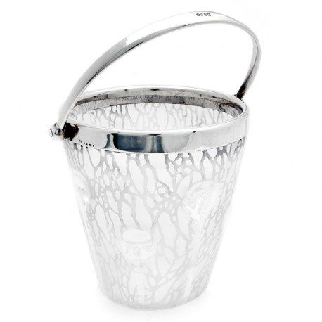 A beautiful Art Nouveau style English glass and silver plate ice pail. The glass has an acid etched design with eight clear glass bullions and trails leading down to the base. The collar is silver plated and the swing handle is marked EPNS. Very good condition. Circa 1900