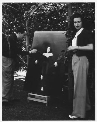 Again with Reginald Gardiner who is finishing a painting of Hedy