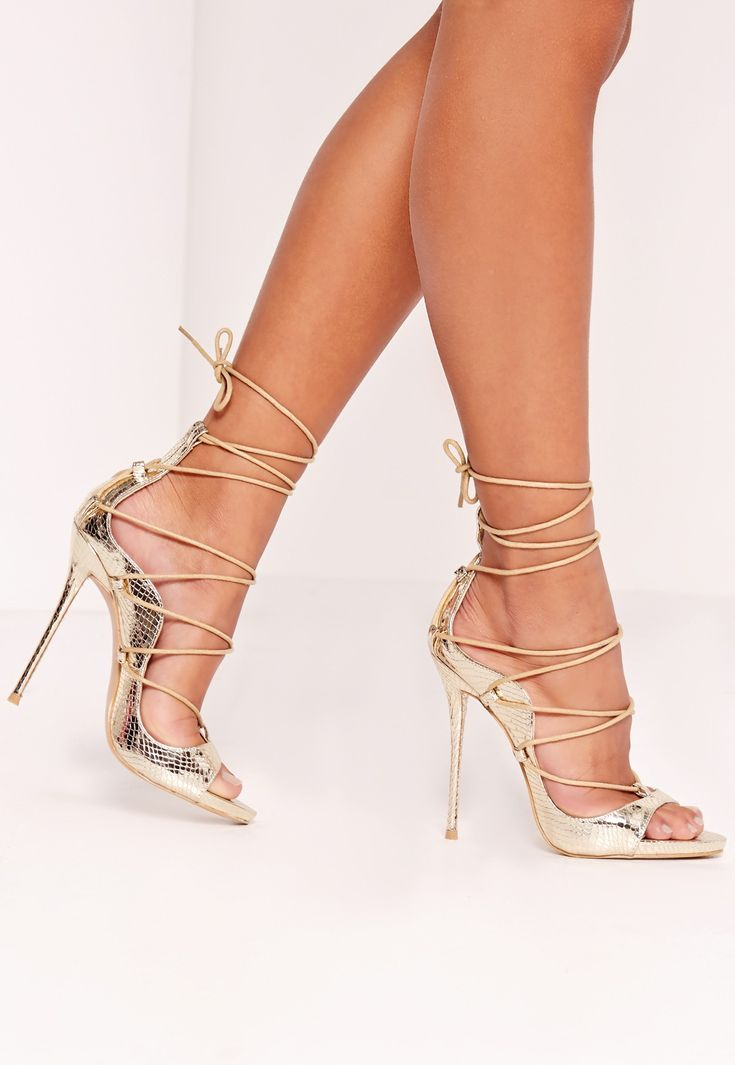 Argh! I love this heels! Peace + Love Reptile Lace Up Heeled Sandals Gold. with lace up detailing, reptile texture and luxe styling, these babies will have you struttin' your stuff in style! (affiliate)