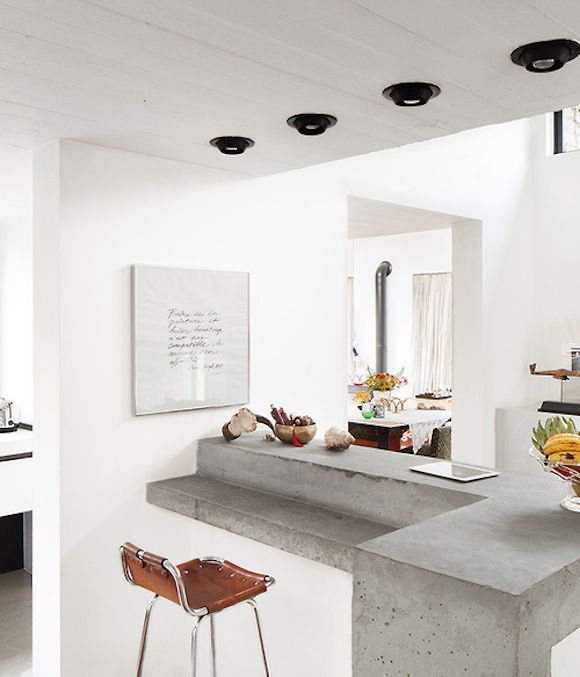 Love the concrete and the stool. Way too much white in the space for me.