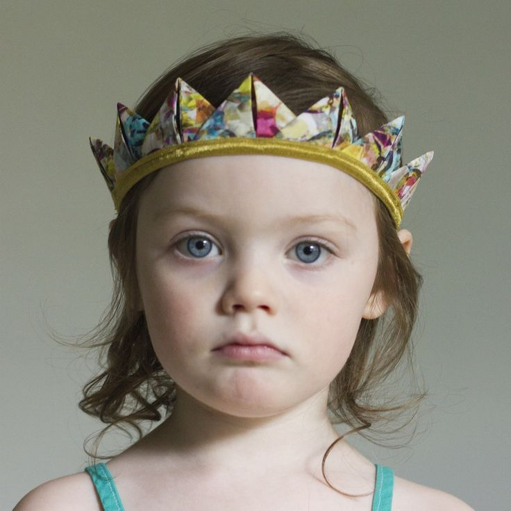 Our Crown Headband is perfect for all ages and occasions: birthdays, make-believe play, special occasions, or everyday wear. Each fabric crown is bound in soft + stretchy fold over elastic and is reversible--wear it with the flat side or pleated side facing out. Each crown point is about 1.5