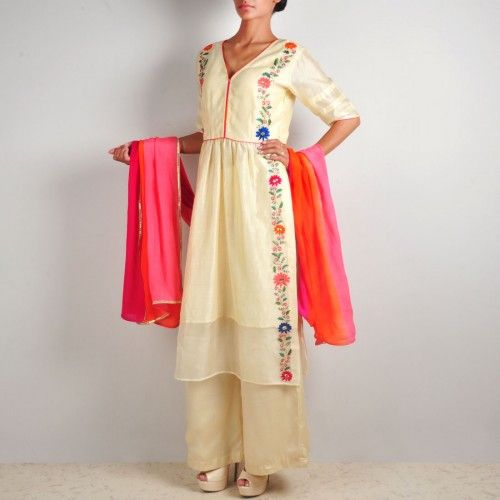 Cream Embroidered Chanderi Tunic-Palazzo Set -  The freshness of a flower bedecked garden, the freedom of birds in flight, and the lightness of morning breeze comes alive in this ensemble. The delicate Chanderi tunic is ornate with floral motifs embroidered with hand, and piping highlights on the bodice. The set includes a pair of palazzos and bright coloured dupatta. Shop here: http://www.tadpolestore.com/