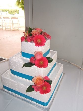 Tiffany Blue With Peach And Pink Flowers Adorn This Square Three Tier Wedding Cake